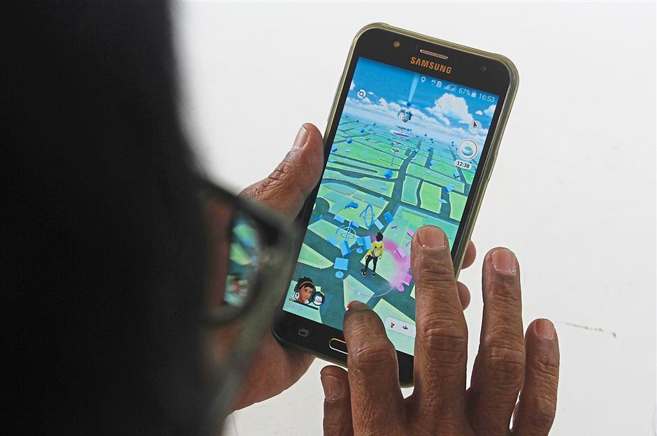 Thanks to Pokemon Go, more industries are looking at augmented reality as an additional source of income. — ZHAFARAN NASIB/The Star