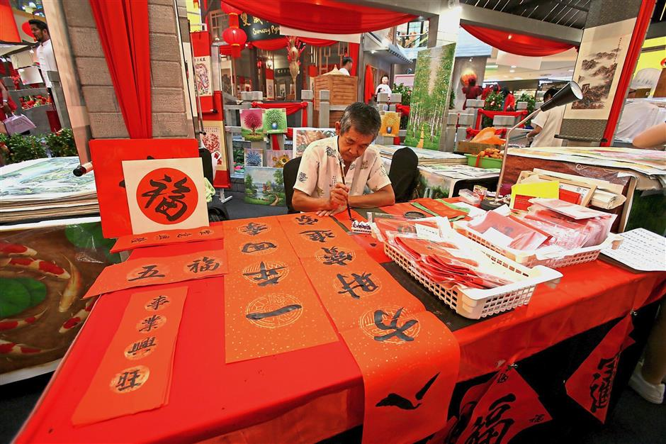 Master Lee of Sketchwalk Kuala Lumpur manning the calligraphy booth, where visitors can get spring couplets for their homes.