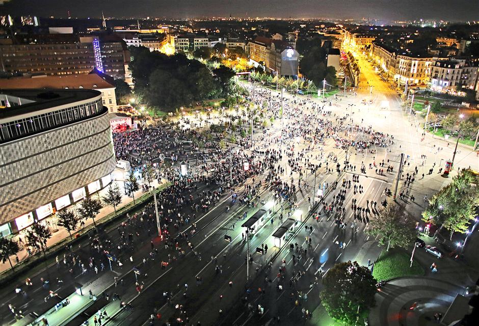 """Visitors crowd the streets during the Festival of Lights celebration marking the 25th anniversary of the Peaceful Revolution in Leipzig, Germany, earlier this month. Doctors say that if we don't go to bed at dusk every day, we can experience """"mini jetlag"""". - EPA"""