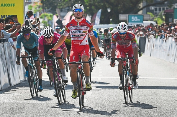 Slick Italian job: Marco Benfatto of Androni Giocattoli (centre) celebrating after winning Stage 8 of Le Tour de Langkawi from Dataran Lang to Kuah in Langkawi yesterday. — AFP