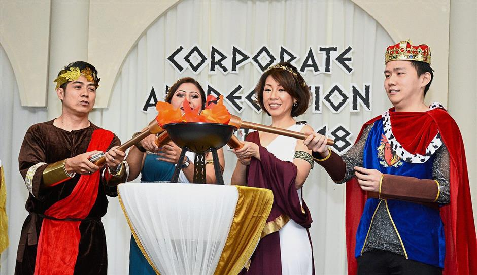 (From left) Badli, Nornazia, Choo and Lim lighting a replica of the Olympic torch to kick start the Greek-themed Corporate Appreciation Night 2018 at Eastin Hotel Penang.