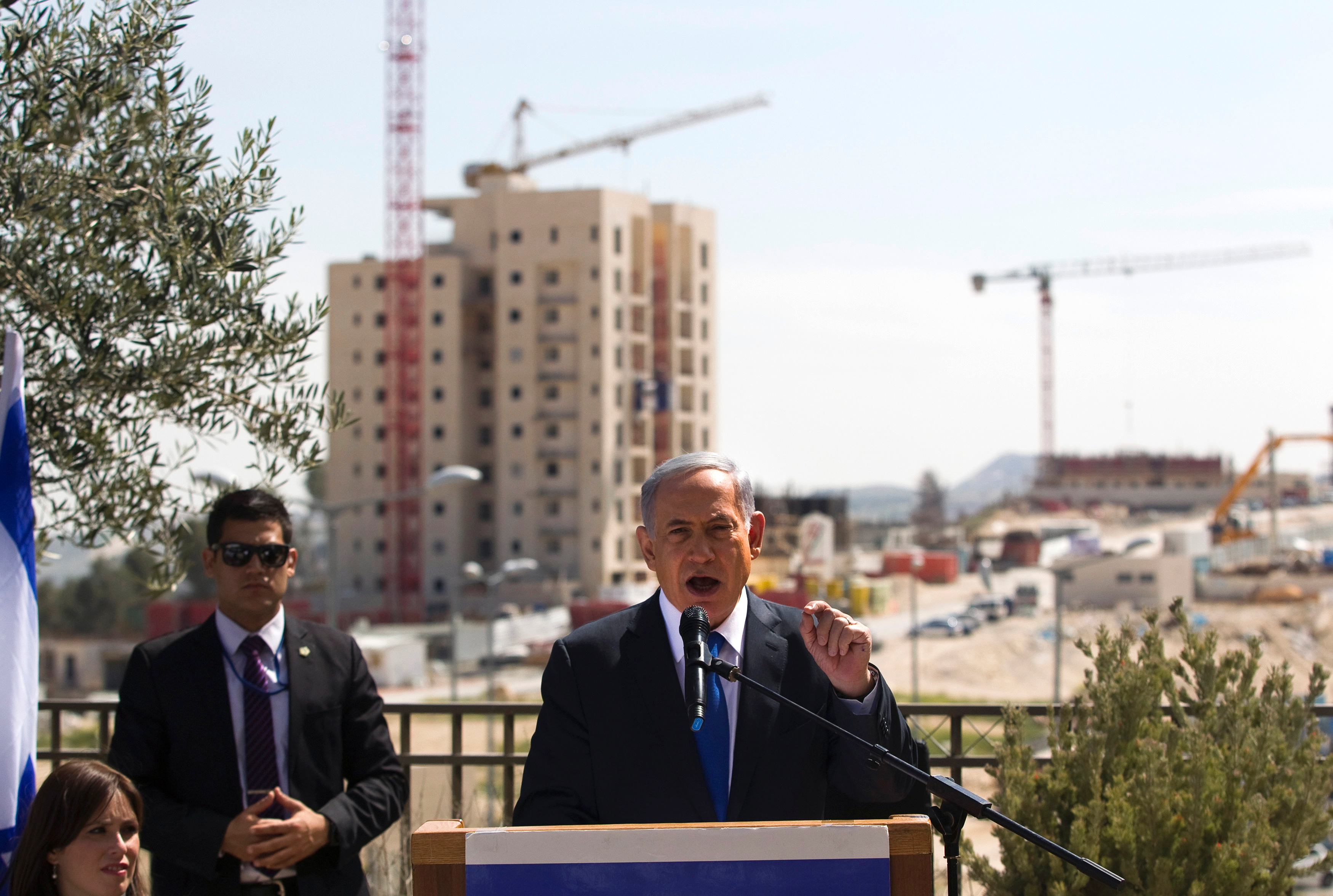 FILE PHOTO: Israeli Prime Minister Benjamin Netanyahu delivers a statement in front of new construction in the Jewish settlement known to Israelis as Har Homa and to Palestinians as Jabal Abu Ghneim in an area of the West Bank that Israel captured in a 1967 war and annexed to the city of Jerusalem, March 16, 2015. REUTERS/Ronen Zvulun/File Photo