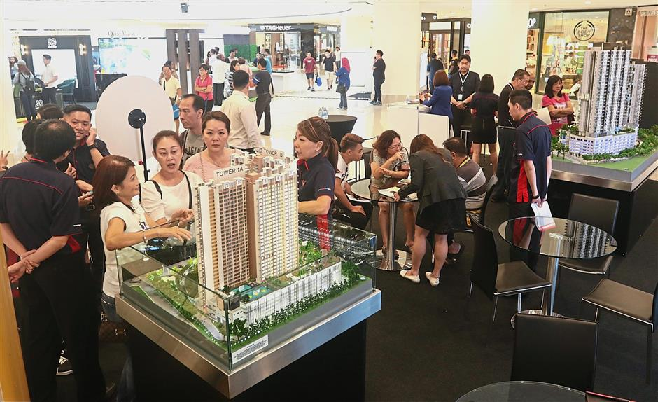 ^ Visitors checking out a project at the SP Setia booth.