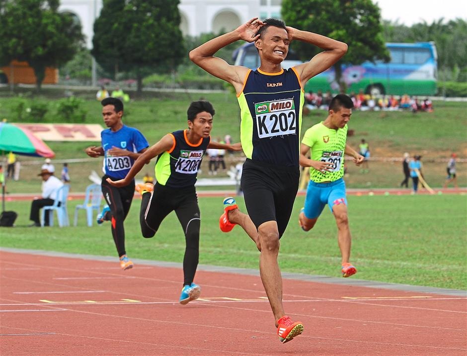 Way to go: Hulu Langat's Ilham Suhaimi knows he has the gold medal in the 200m in Boys Class Two.