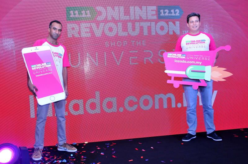 Lazada Malaysia chief executive officer Hans-Peter Ressel (right) and chief marketing officer Andrew Gnananantham launching the Online Revolution 2017