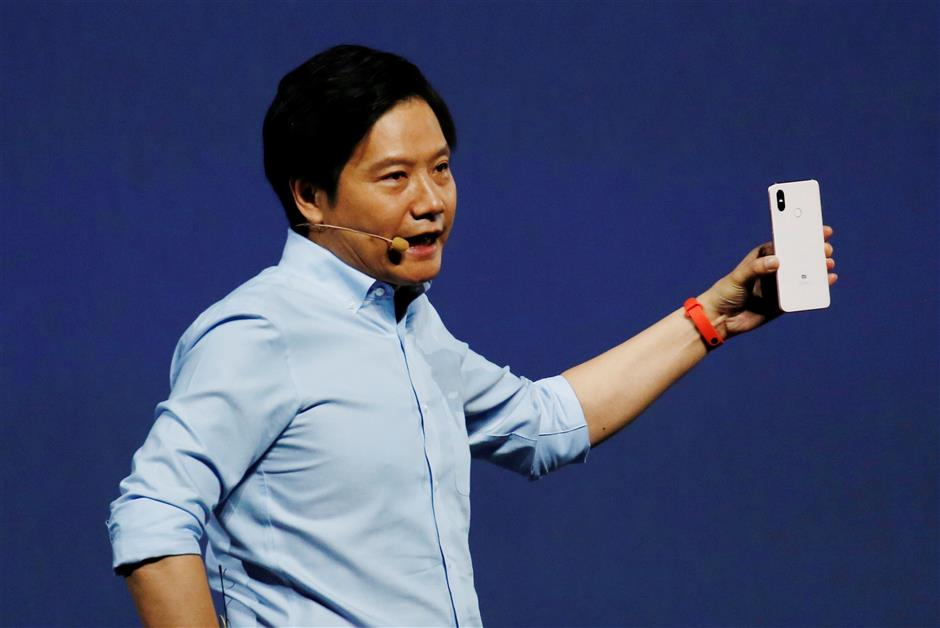 Xiaomi founder Lei Jun introduces the flagship Mi 8 during a product launch in Shenzhen, China May 31, 2018. REUTERS/Bobby Yip