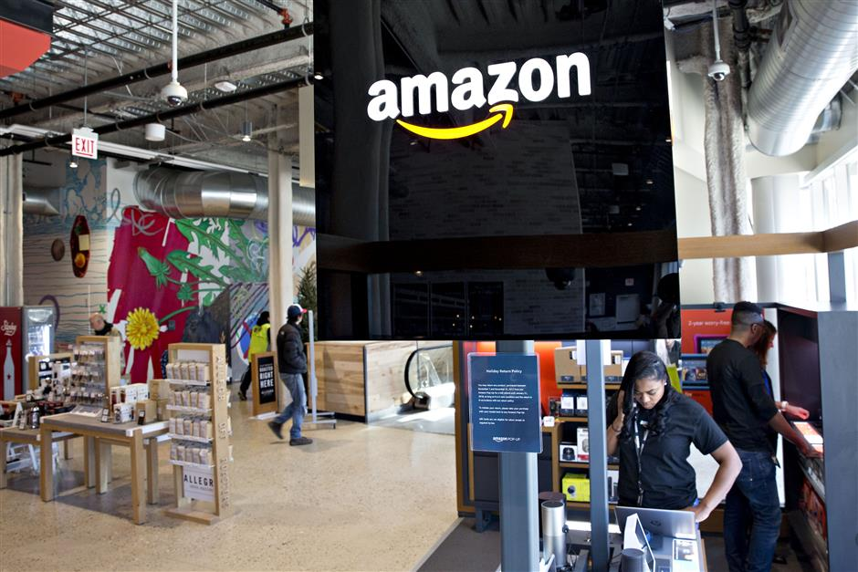 Signage is displayed in at an Amazon.com Inc. Pop-Up store inside the Lakeview Whole Foods Market Inc. store in Chicago, Illinois, U.S., on Monday, Nov. 20, 2017. Amazon.com Inc.u00a0is betting that people shopping for discounted organic Thanksgiving turkeys at Whole Foods this week may decide to pick up an Echo digital assistant as well.u00a0The company is using the holiday moment and its broader brick-and-mortar presence to further a lead in the emerging market for voice-activated smart home speakers. Photographer: Daniel Acker/Bloomberg
