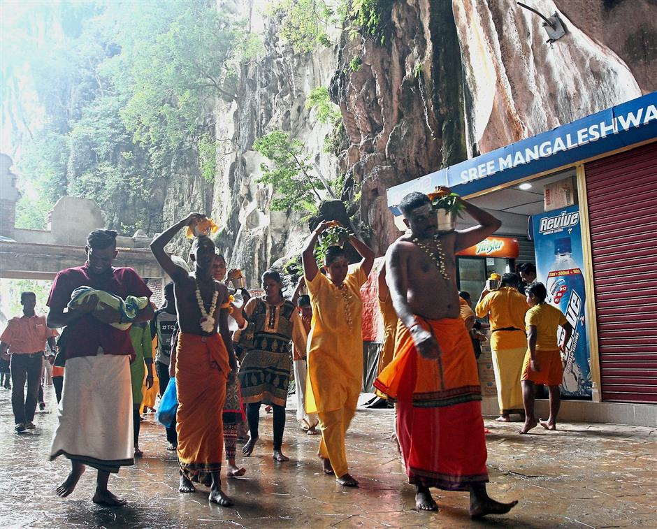 Batu Caves is crowded with people offering their prayers and vows ahead of Thaipusam due to the lunar eclipse tonight.