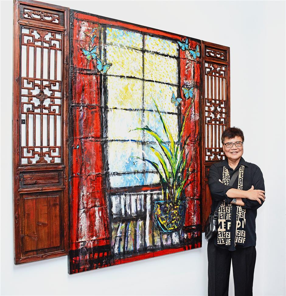 Quah posing with one of his favourite pieces 'Beautiful Sunday', which incorporates antique window frames.