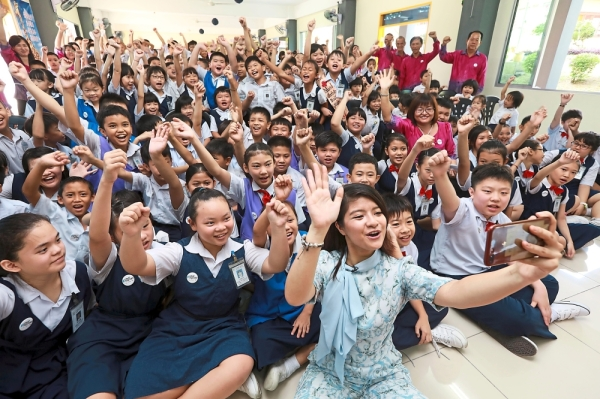 Mass cheer: Performer Nik Qistina pictured here during a Kindness Week school visit.