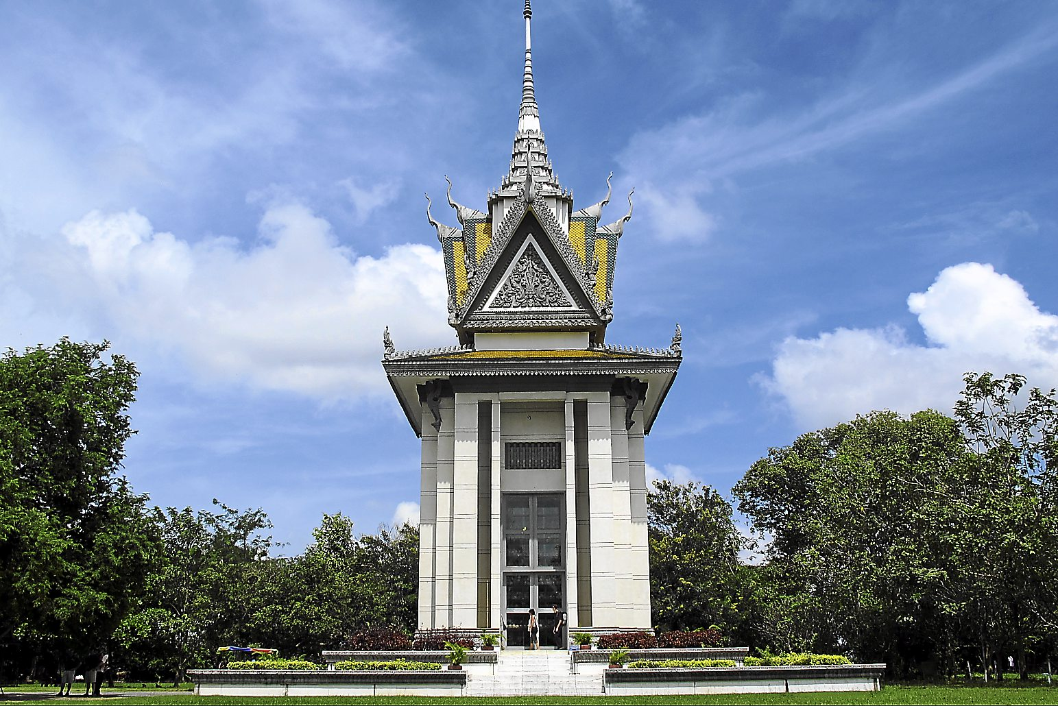 The Bhuddist Stupa at Choeung Ek, Cambodia, that houses thousands of skulls of the victims from the Khmer Rouge regime in the 1970's. - Photo from Wikimedia Commons