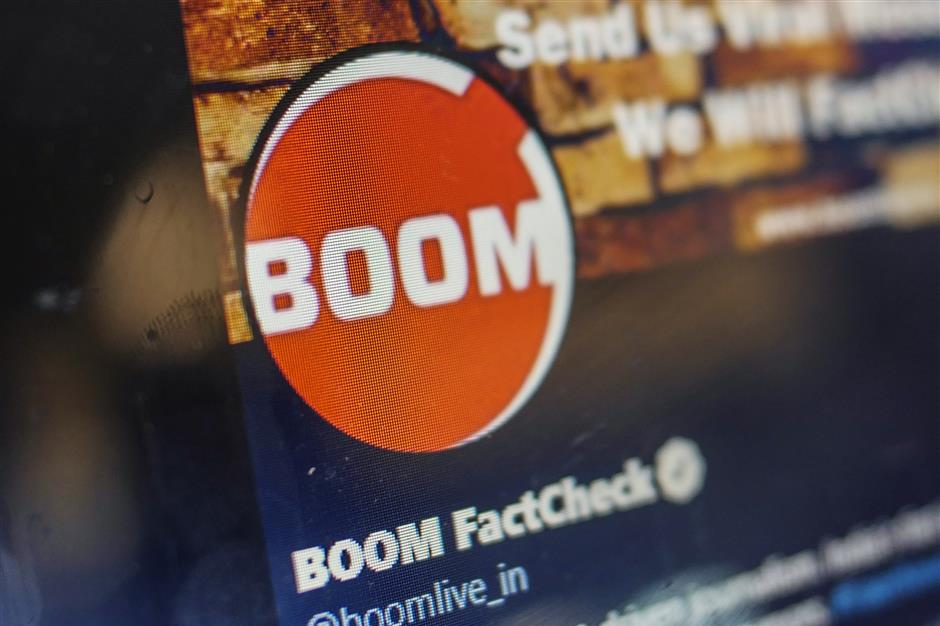 Boom Live's Twitter Inc. profile page is arranged for a photograph at Boom's offices in Mumbai, India, on Friday, March 28, 2019. Boom is one of seven tiny fact-checking firms at the heart of Facebook Inc.'s efforts to rebuild some of its credibility during India's elections. Photographer: Dhiraj Singh/Bloomberg