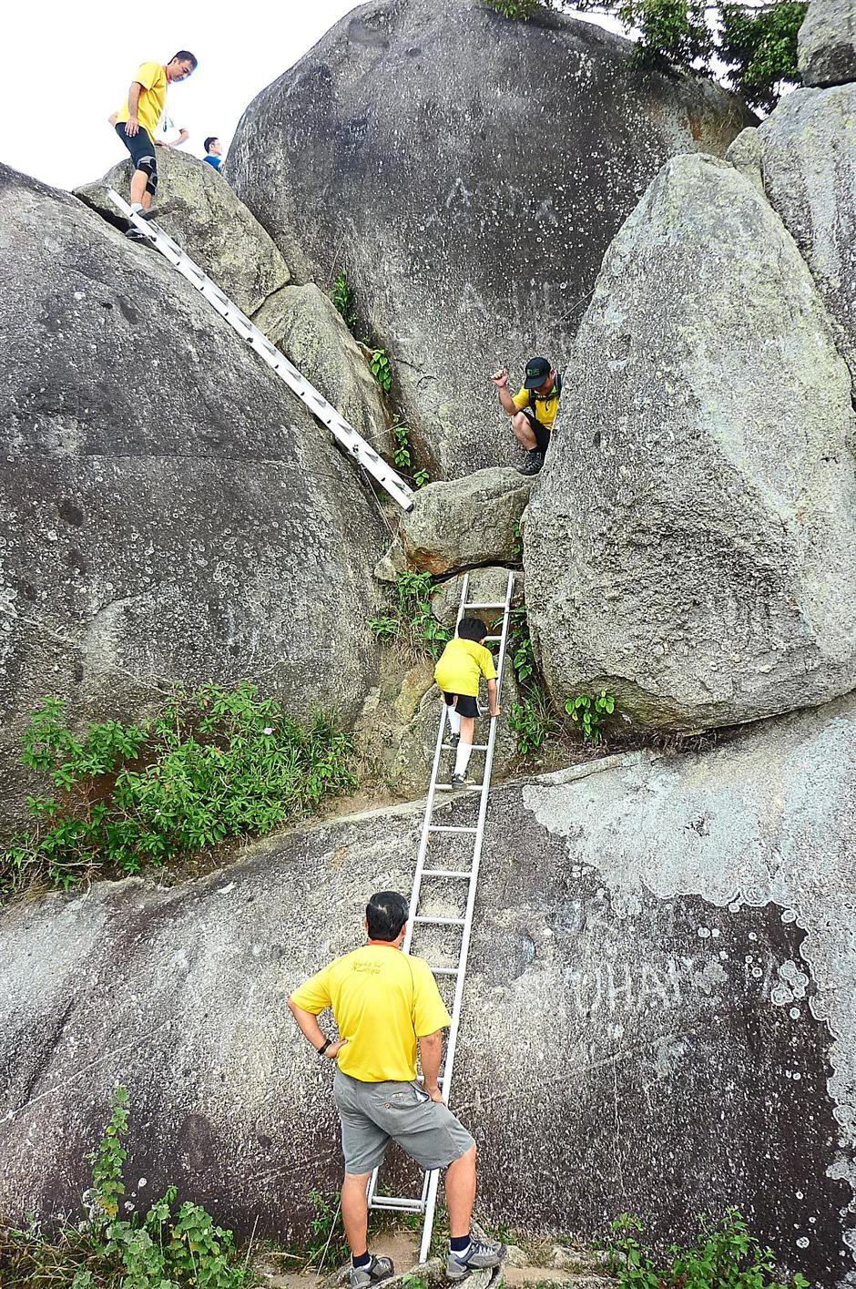 To reach the actual peak of Gunung Datuk, the writers family had to clamber up these ladders.