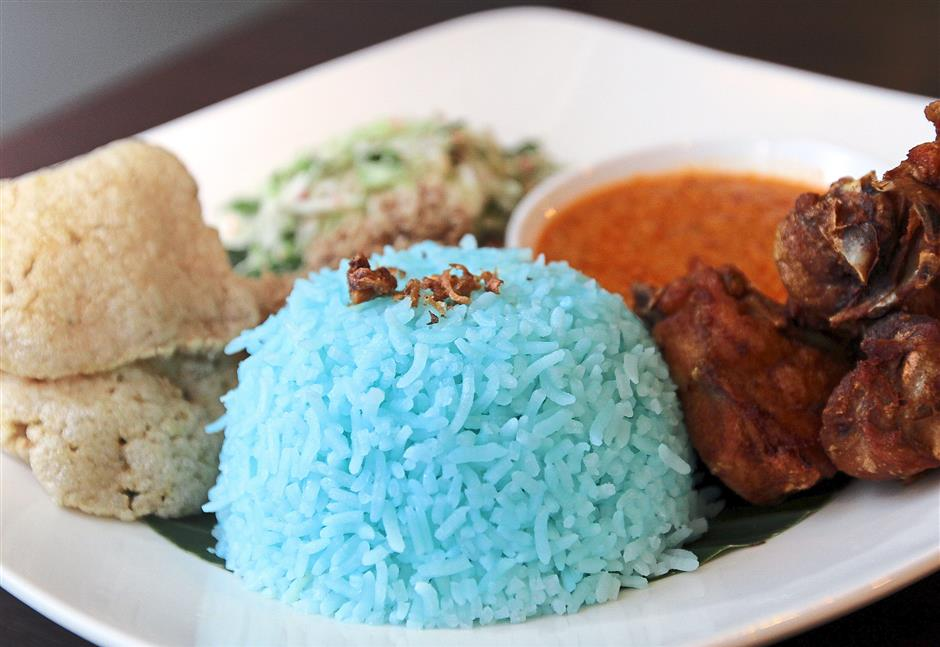 Go local: The Nasi Kerabu with blue rice is a popular dish at the Suasa Restaurant in Habib Hotel.