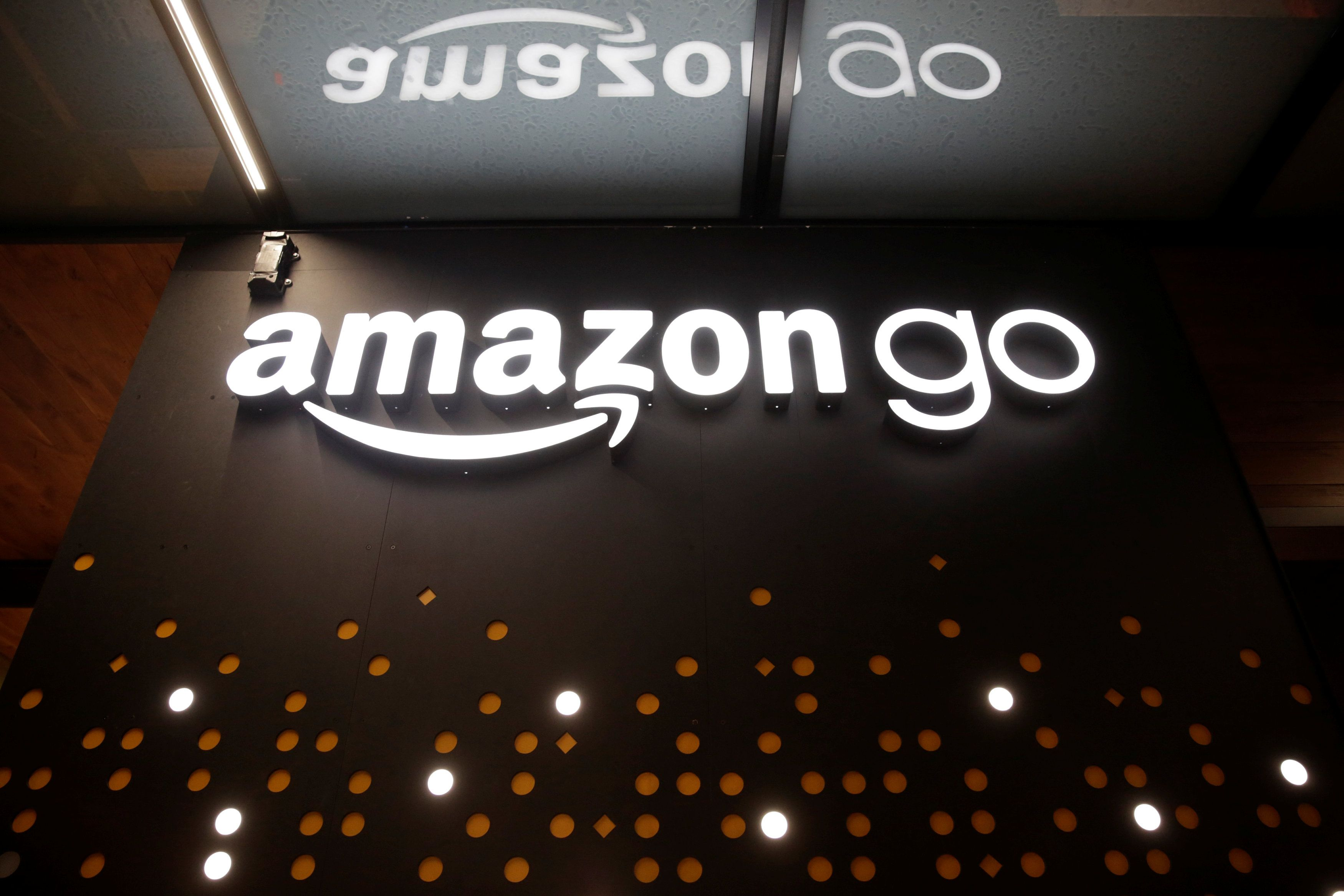 The sign for the Amazon Go brick-and-mortar grocery store without lines or checkout counters, is pictured in Seattle Washington, U.S. December 5, 2016. REUTERS/Jason Redmond