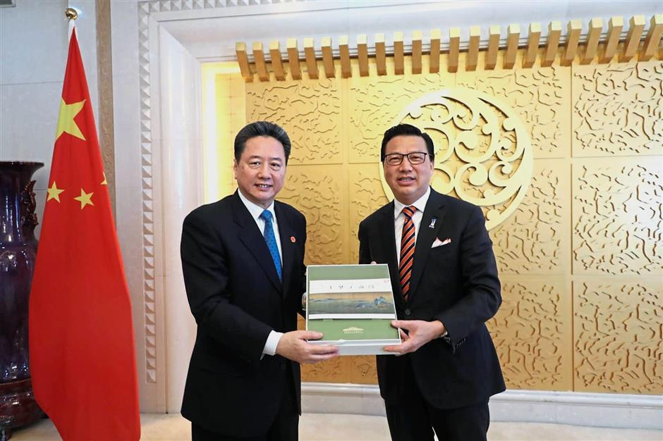 Stronger ties: Liow (right) and Li exchanging mementos after a meeting to discuss bilateral cooperation between the two nations.