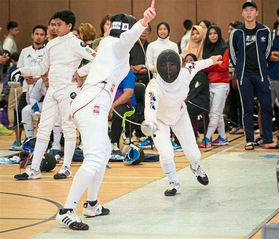 Two of the fencers in action in the Womens Epee event at the Prince of Wales International School in Balik Pulau recently.(16/10/15)