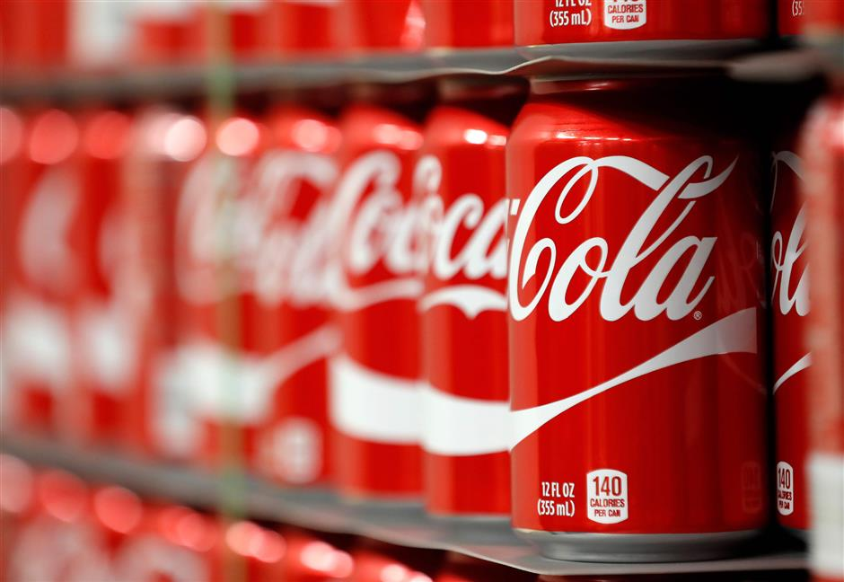 (FILES) This file photo taken on February 9, 2017 shows pallets of Coke-Cola cans waiting to the filled at a Coco-Cola bottling plant in Salt Lake City, Utah. Coca-Cola reported a jump in third-quarter profits on October 25, 2017 due to lower expenses as it broadens offerings of non-cola drinks to offset sluggish demand for its namesake product in North America.Earnings for the quarter ending September 29 came in at $1.4 billion, up 38.3 percent from the year-ago period. Revenues fell 14.6 percent to $9.1 billion due to the refranchising of bottling operations. / AFP PHOTO / GETTY IMAGES NORTH AMERICA / GEORGE FREY