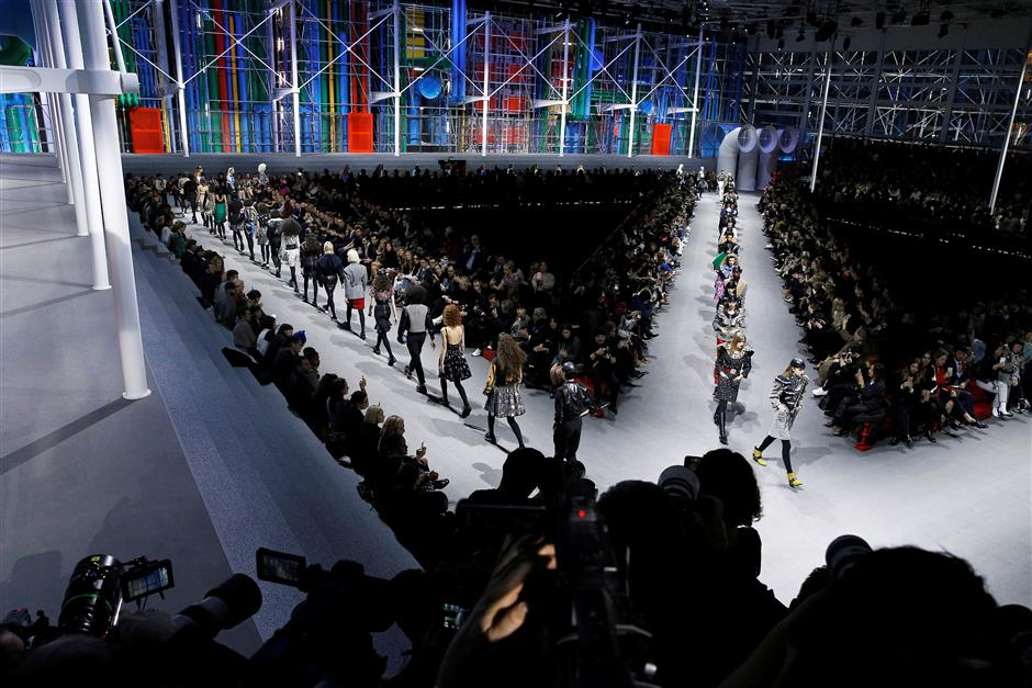FILE PHOTO: Models present creations by French designer Nicolas Ghesquiere as part of his Fall/Winter 2019-2020 women\'s ready-to-wear collection show for Louis Vuitton during the Paris Fashion Week in Paris, France, March 5, 2019.  REUTERS/Stephane Mahe/File Photo