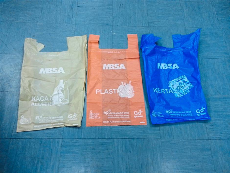 Organise your trash: The plastic bags to separate glass, aluminium, plastic and paper that MBSA will be providing for the recycling programme.