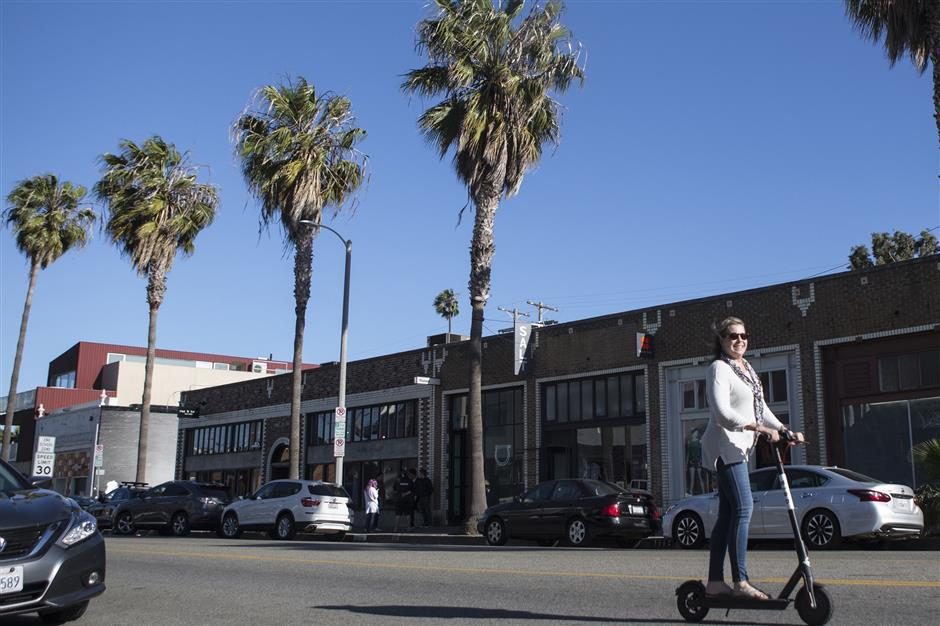 Many locals use Bird scooters to get to and from locations close to home. (Maria Alejandra Cardona/Los Angeles Times/TNS)