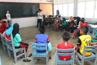 Learning together: At the weekly English Club session, the children of Pulau Perhentian get to learn new words, play games, and receive gifts too.