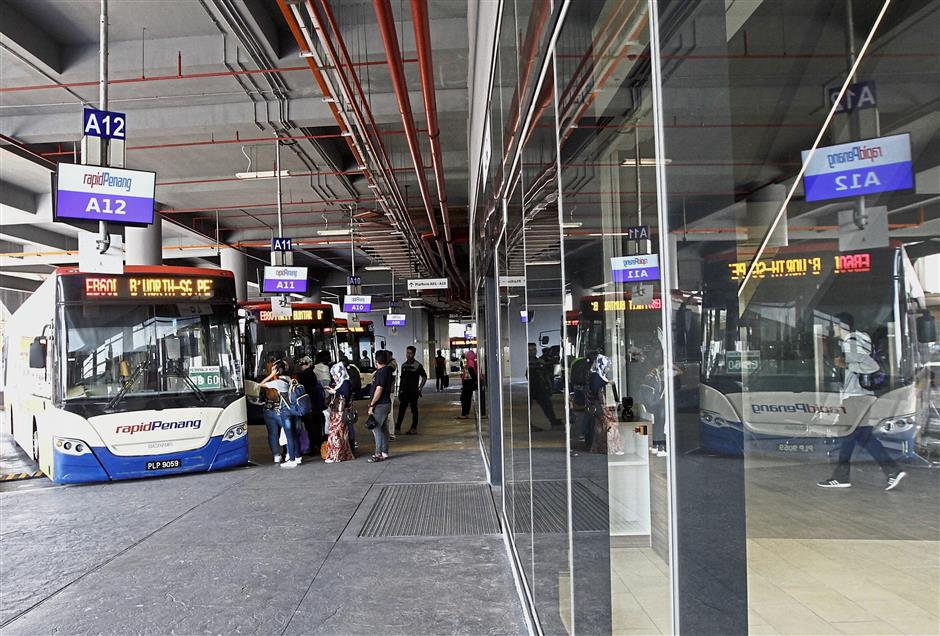 Passengers waiting on Level One for their buses at Penang Sentral in Butterworth.