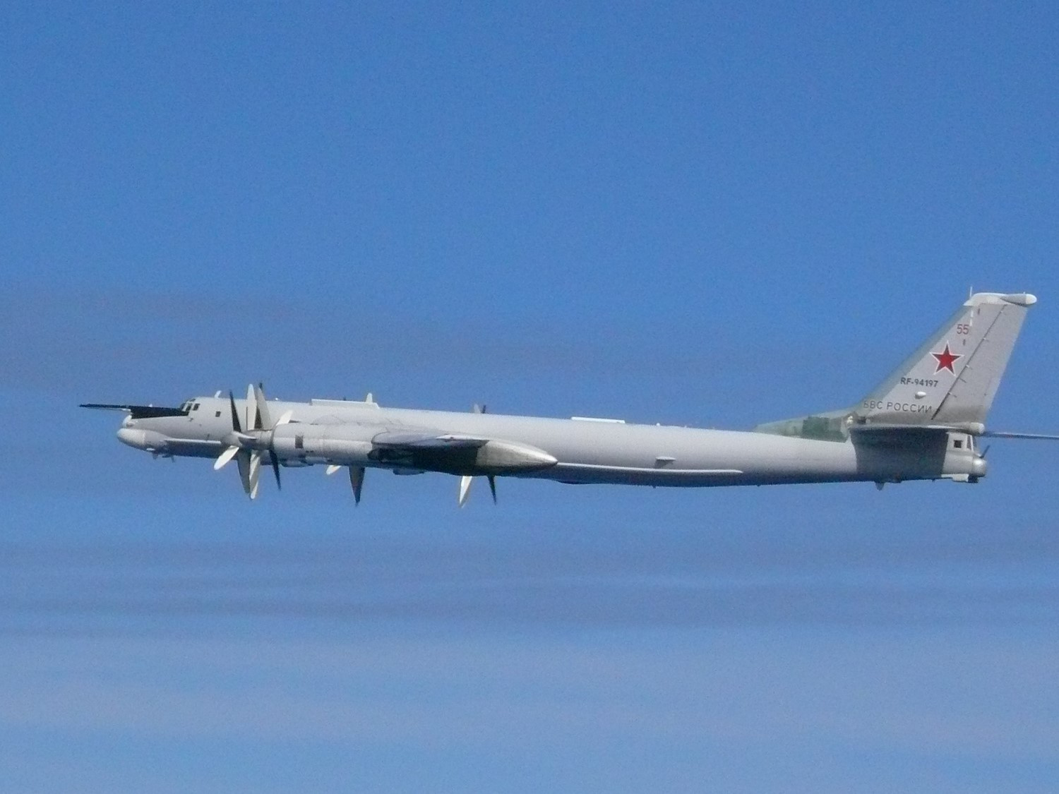 A Russian TU-95 bomber flies over East China Sea in this handout picture taken by Japan Air Self-Defence Force and released by the Joint Staff Office of the Defense Ministry of Japan July 23, 2019. Joint Staff Office of the Defense Ministry of Japan/HANDOUT via REUTERS