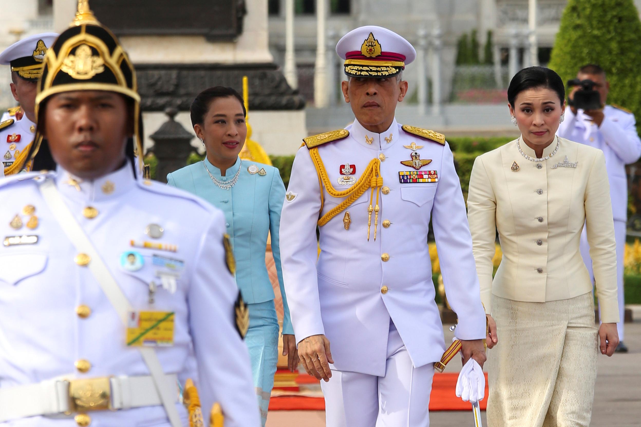Thailand's King Maha Vajiralongkorn, Queen Suthida and Princess Bajrakitiyabha leave after paying their respect at the statue of King Rama V at the Royal Plaza in Bangkok, Thailand, May 2, 2019. Pool via Reuters