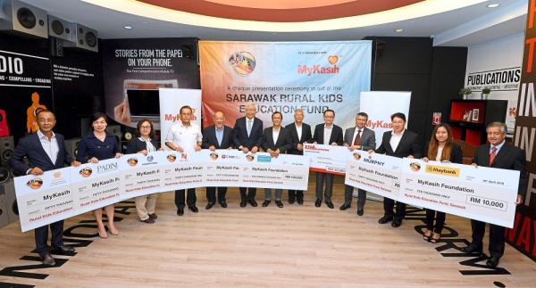 For a good cause: Fu (fifth from right) with Ngau (sixth from left), Wee (centre) and the other corporate donors at the cheque presentation at Menara Star, Petaling Jaya.