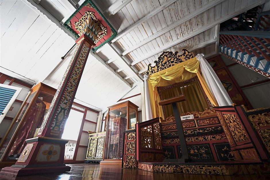 Rich in meaning: The carvings in the house bear floral and animal motifs, as well as Chinese elements such as Ang Ling or Red Dragon (linked to wealth and power) and Eng Ling or Gold Dragon (linked to authority and protection). — Bernama