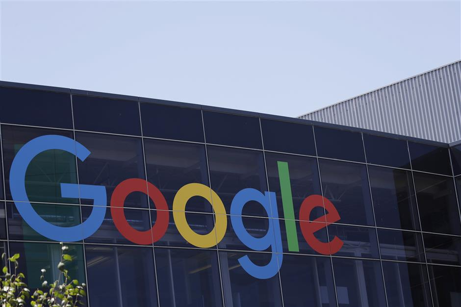 FILE - This Tuesday, July 19, 2016, file photo shows the Google logo at the company\'s headquarters in Mountain View, Calif. Google parent Alphabet Inc. reports earnings Thursday, Feb. 1, 2018. (AP Photo/Marcio Jose Sanchez, File)