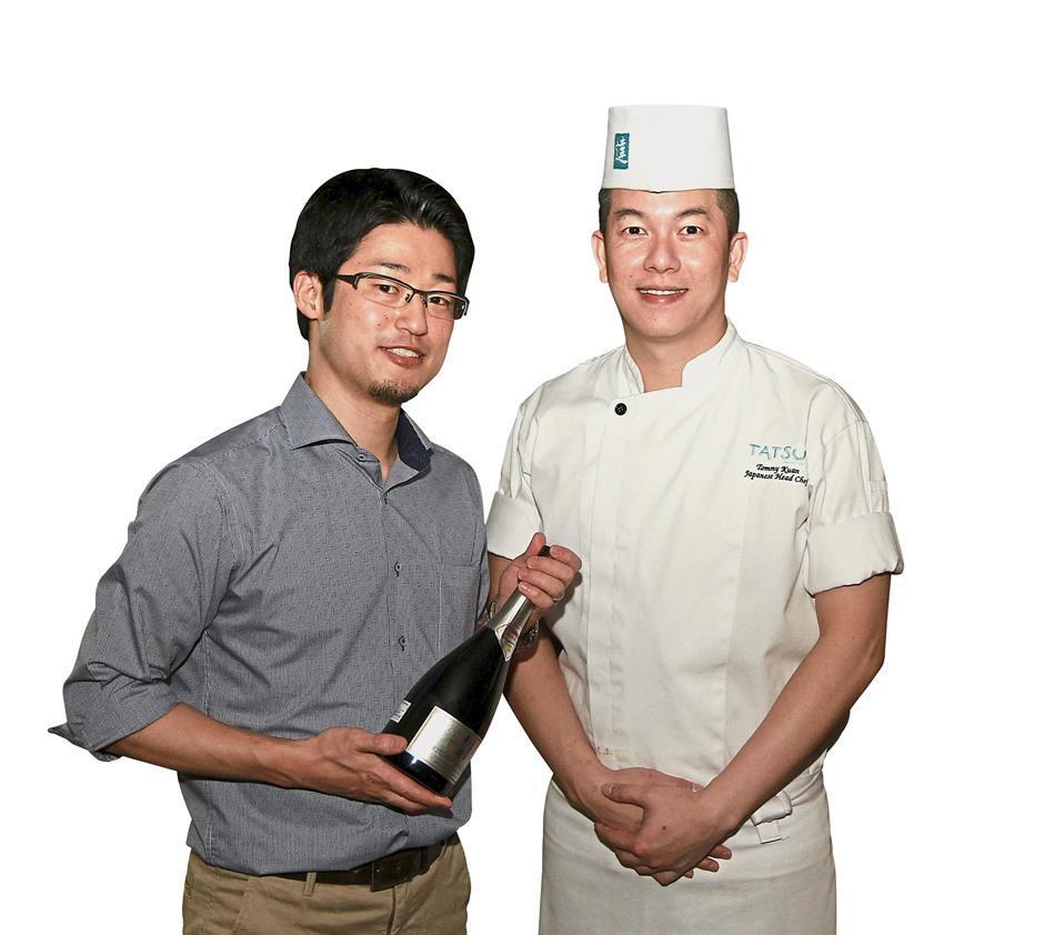 Kuan (right) with Tojo at the sake-pairing dinner at Tatsu.