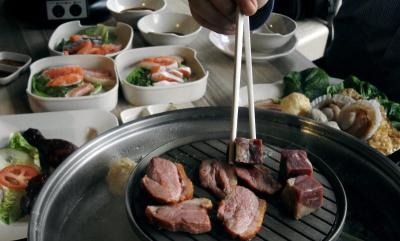 To be boiled or grilled: The steamboat pot is designed to contain one kind ofsoup, while the grill in the centre allows diners to barbecue their meats.