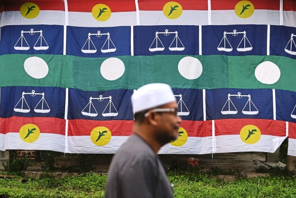 Friends with benefit: PAS and Umno can clinch more seats if they work together in GE15.