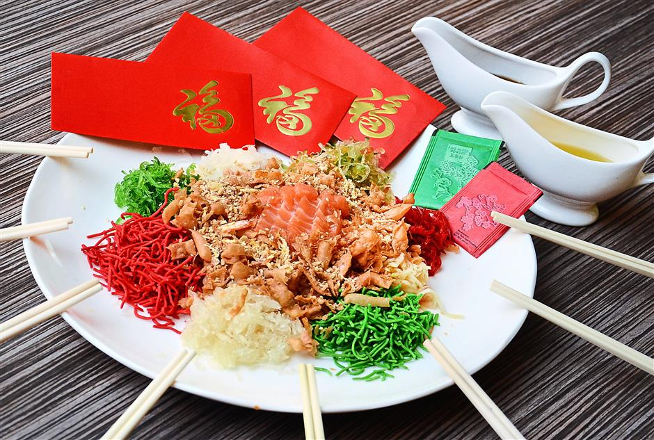 Toss your way to success: The festive buffets include a serving of Prosperity Salmon Yee Sang for every table.