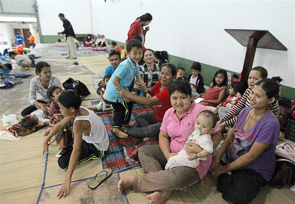 Flooded out: Evacuees resting at SK St Peter, Simpok in Padawan, about 60km from Kuching.