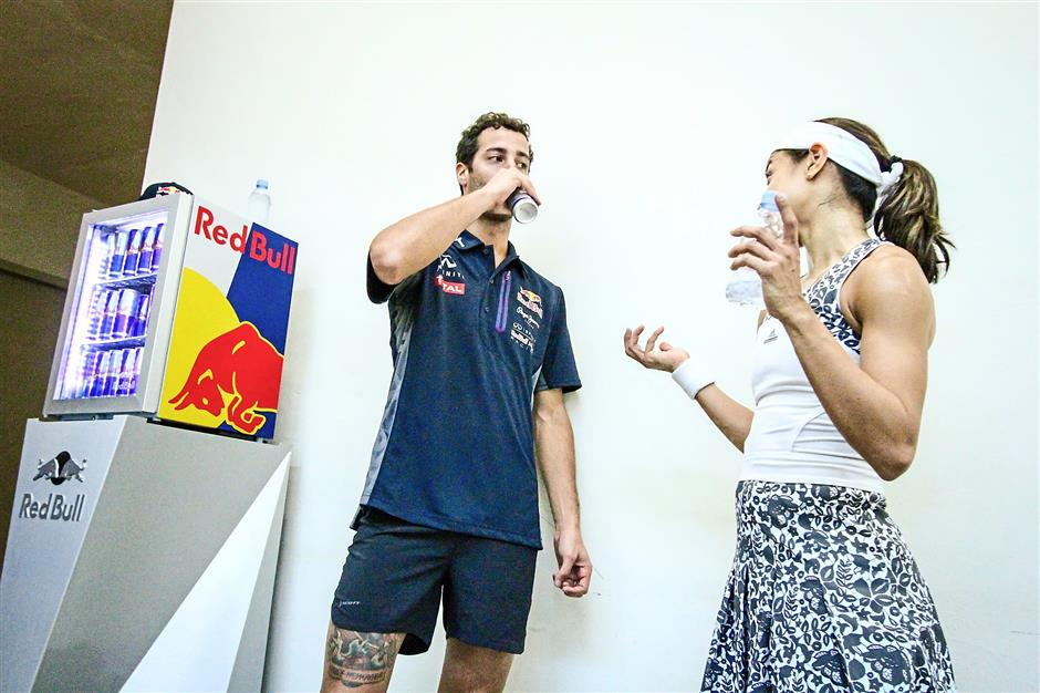 Thirst quencher: Ricciardo taking a Red Bull break with David after being declared the victor in the battle.
