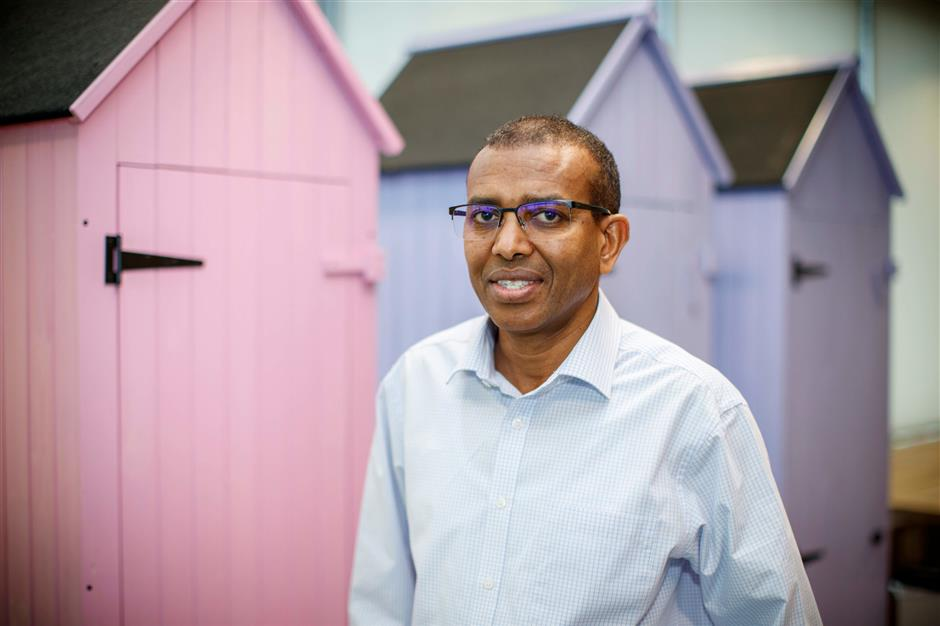 Ismail Ahmed, founder and CEO of WorldRemit poses at their offices in London on March 5, 2019. - The money transfer business is personal for Ismail Ahmed. It was money wired by his brother that allowed him to make the final leg of his journey from escaping fighting in his native Somaliland to London in 1988 to take up a university scholarship. (Photo by TOLGA AKMEN / AFP)