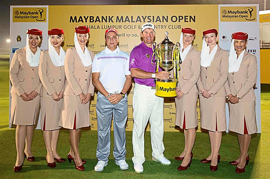 Kavin celebrates with the champion of the Maybank Malaysian Open 2014 Lee Westwood (centre).