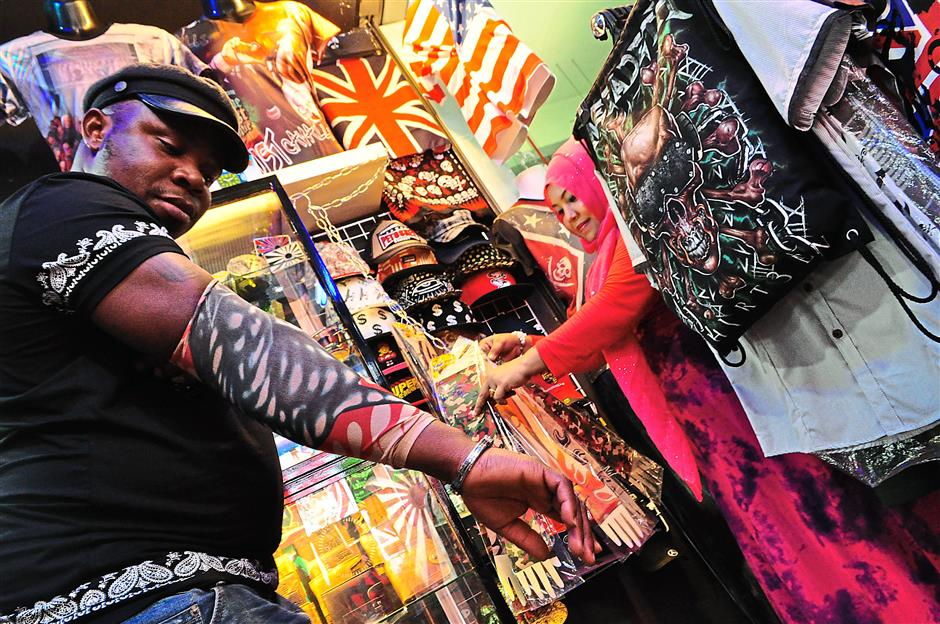 Growing inventory: Liew's stalls also offers accessories like tattoo sleeves popular with fans of rock music.