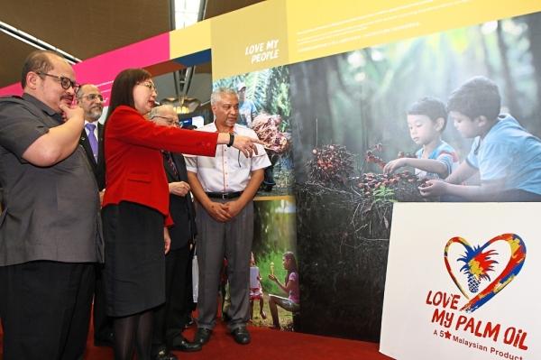 A complex issue: Primary Industries Minister Teresa Kok and her deputy Datuk Seri Datuk Seri Shamsul Iskandar Mohd Akin launching the Malaysian Palm Oil information wall at KLIA in Sepang on Thursday.