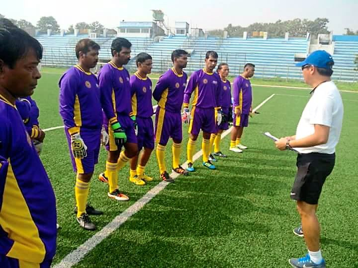 Yong briefing a pool of goalkeepers at the East Bengal Barasat Stadium in India.
