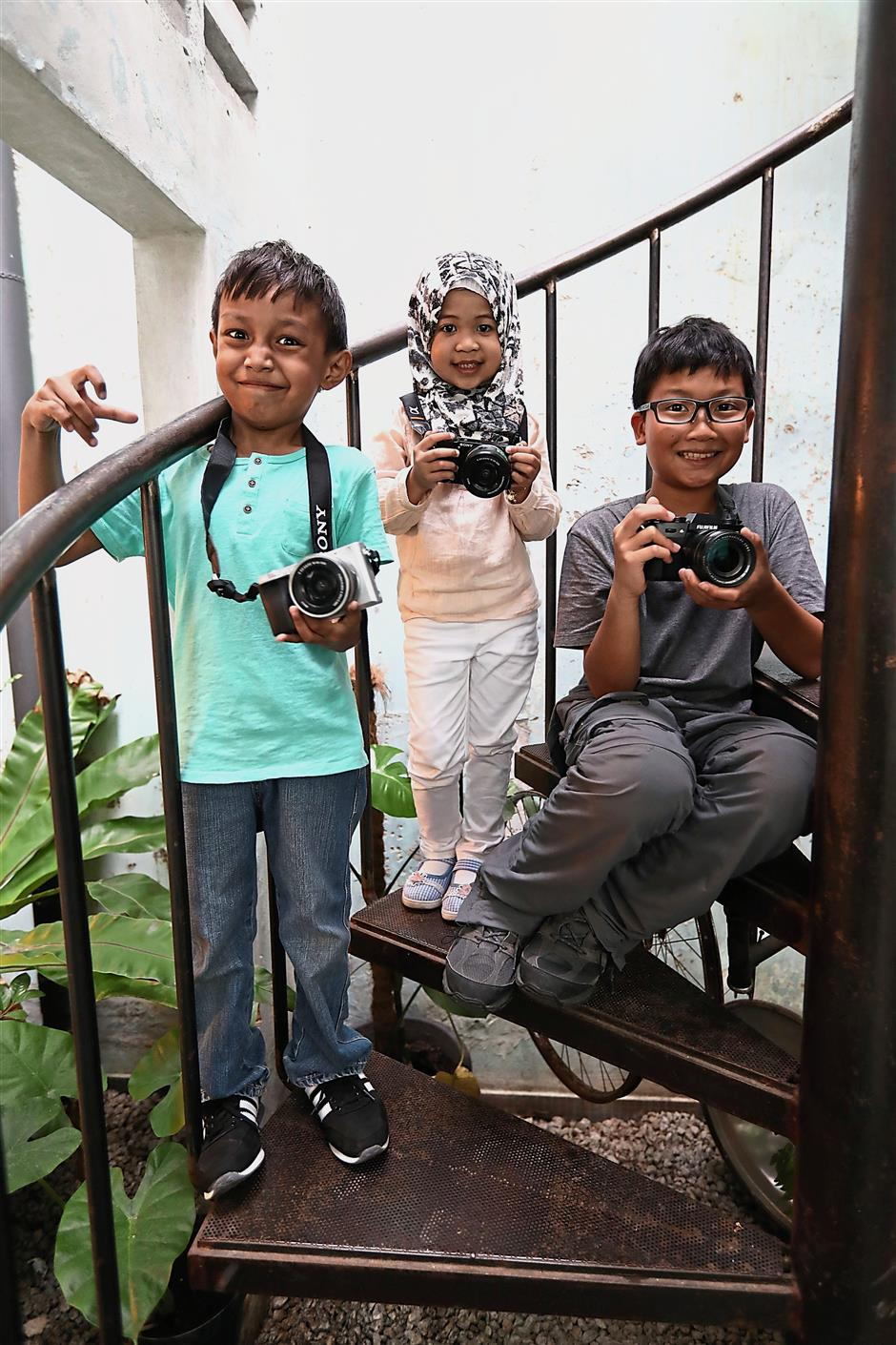 (From left) Muhammad Ayman, Wan Siti and WeiZheng are part of the 10 youngsters featured in Petrons' Cerita Kita television commercial.