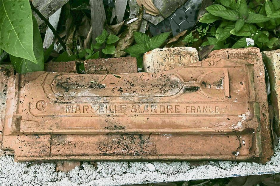 The earthen roof tiles are believed to have been imported from Marseilles, France between 1890 and 1914.
