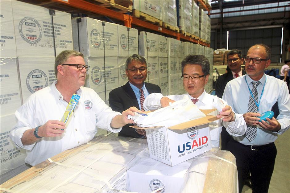 (From left, US Agency for International Development Office of US Foreign Disaster Assistance regional advisor Harlan Dale inspecting relief items with U. S Ambassador to Malaysia Joseph Yun (second from right) at the UN Humanitarian Depot in Subang, yesterday. Looking on National Security Council Deputy Secretary for Disaster Management Ogu Salim Omar (second from left) and WFP-UNHRD Malaysia head Belkacem Benzaza. (right)