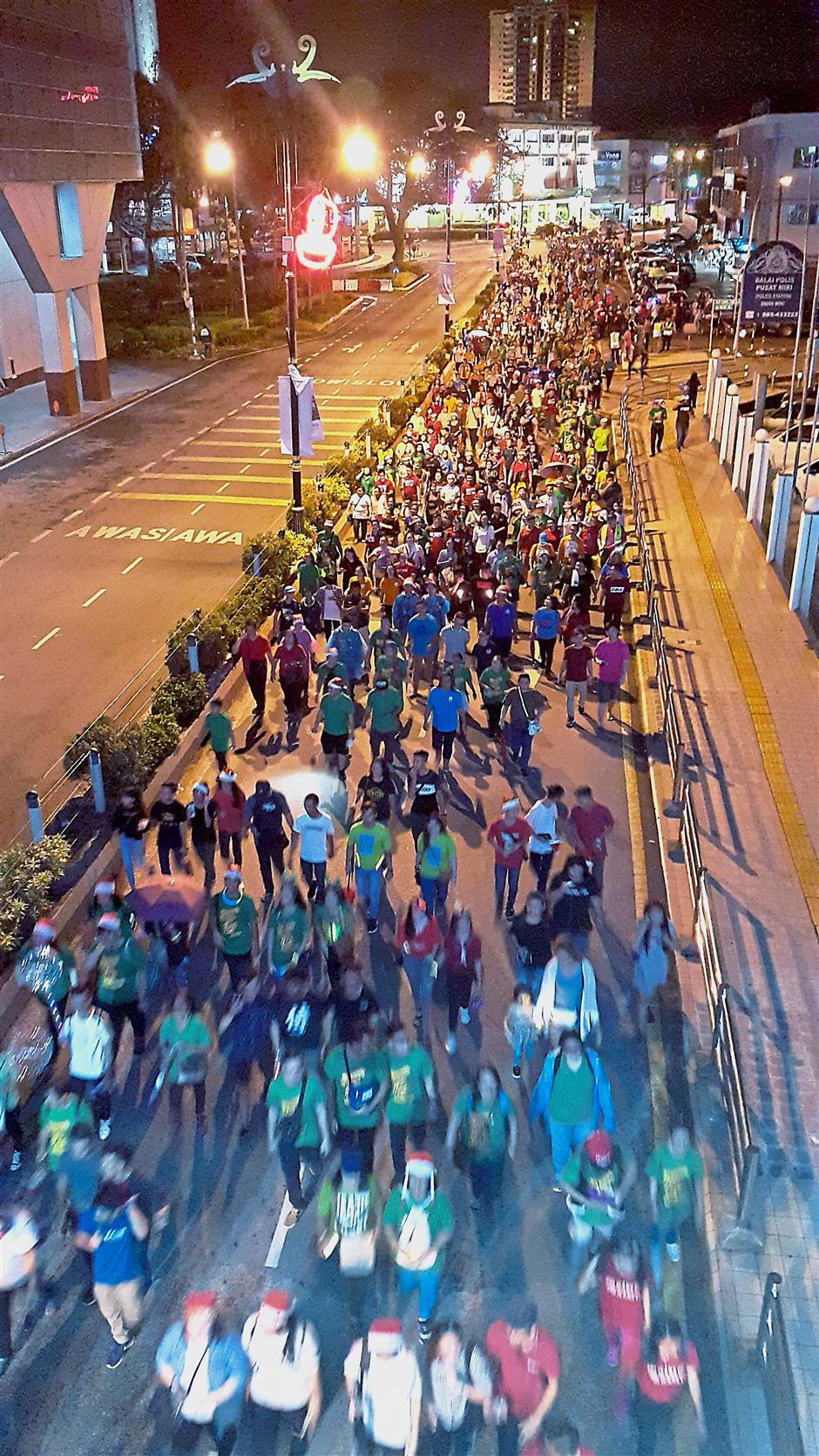 Seasonu2019s greetings:  The crowd of people taking part in the Miri mammoth Christmas parade.