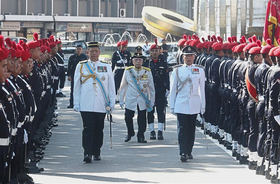 Yang di-Pertua Negri Tun Abdul Rahman Abbas inspecting the guard of honour during the opening ceremony of the state assembly yesterday.