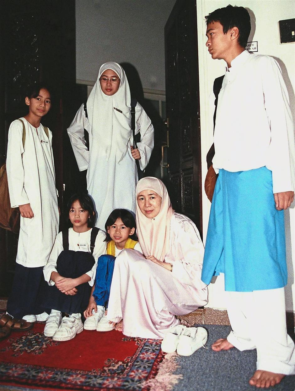 Juggling act: Dr Wan Azizah with her children before they left for school.