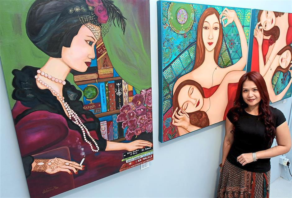 Painting a form of therapy: Teo with her acrylic paintings from her Sama-Sama series, on sale at the Shine Art exhibition.
